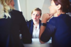 A woman is interviewed for a new position